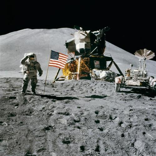 Astronaut with an American flag on the moon