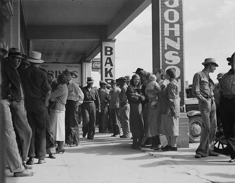 Picture of people waiting for relief checks during the Great Depression